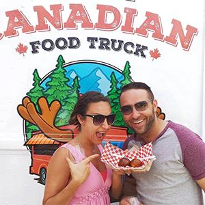 Couple eating from food truck